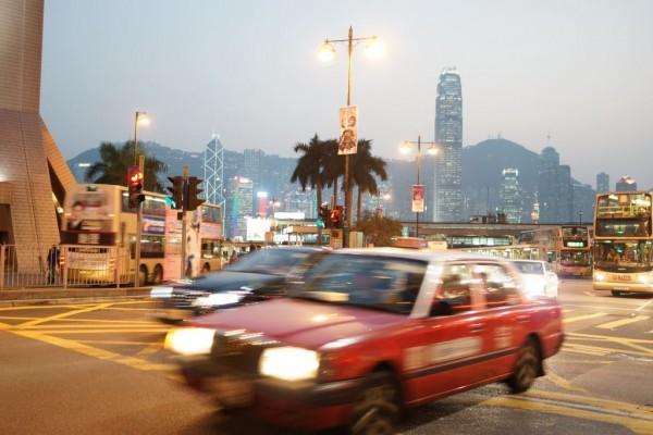Taxi with Hong Kong island skyline