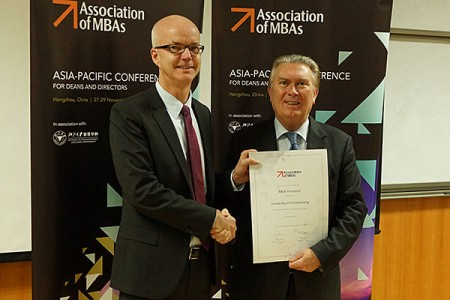 P.O Larsson receives the AMBA Accreditation certificate from Sir Paul Judge